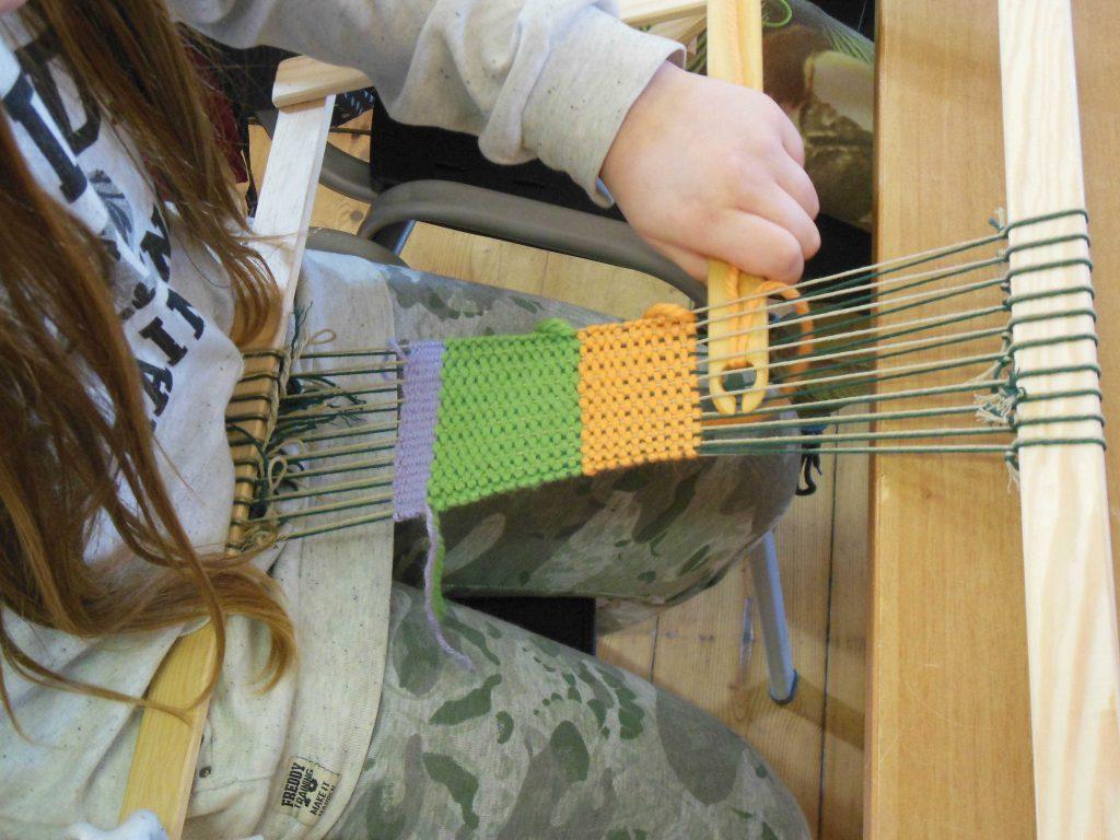 Il laboratorio per apprendisti tessitori